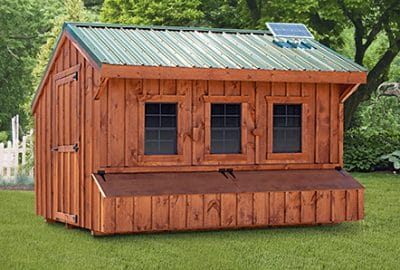 Super Coop with stained pine siding, metal roof, solar package